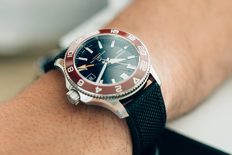 a closeup of a Christopher Ward watch's bezel